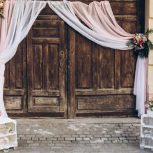 Rustic Wedding Photo Zone. Wooden Barn Doors With Fabric And Whi